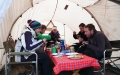 Guests tucking into fresh pancakes in the mess tent.